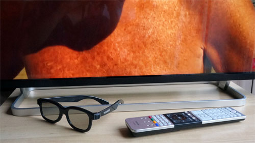 Stand, remote control and polarized 3D glasses