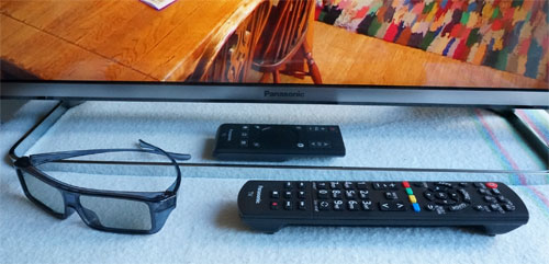 Pedestal stand, remote controls and polarized 3D glasses