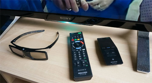 Remote controls, 3D glasses and metal feet stand